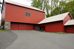 a large red barn used as a storage area